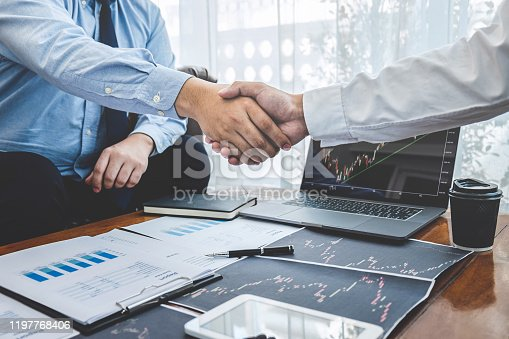 Businessman shaking hands after conversation, Finishing up a collaboration discussing of partner cooperation in investment marketing project and successful contract agreement to become teamwork.