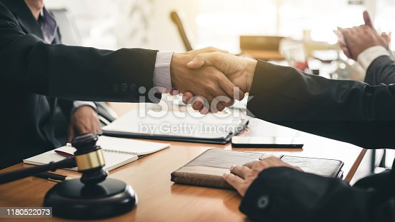 836113188 istock photo Businessman shaking hands discussing a contract agreement. 1180522073