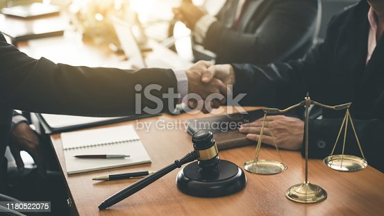istock Businessman shaking hands discussing a contract agreement. 1180522075