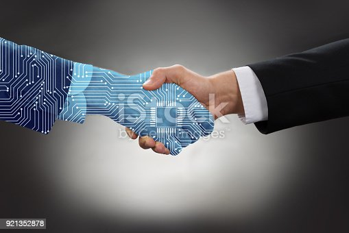 istock Businessman Shaking Hands In Front Of Mallet 921352878
