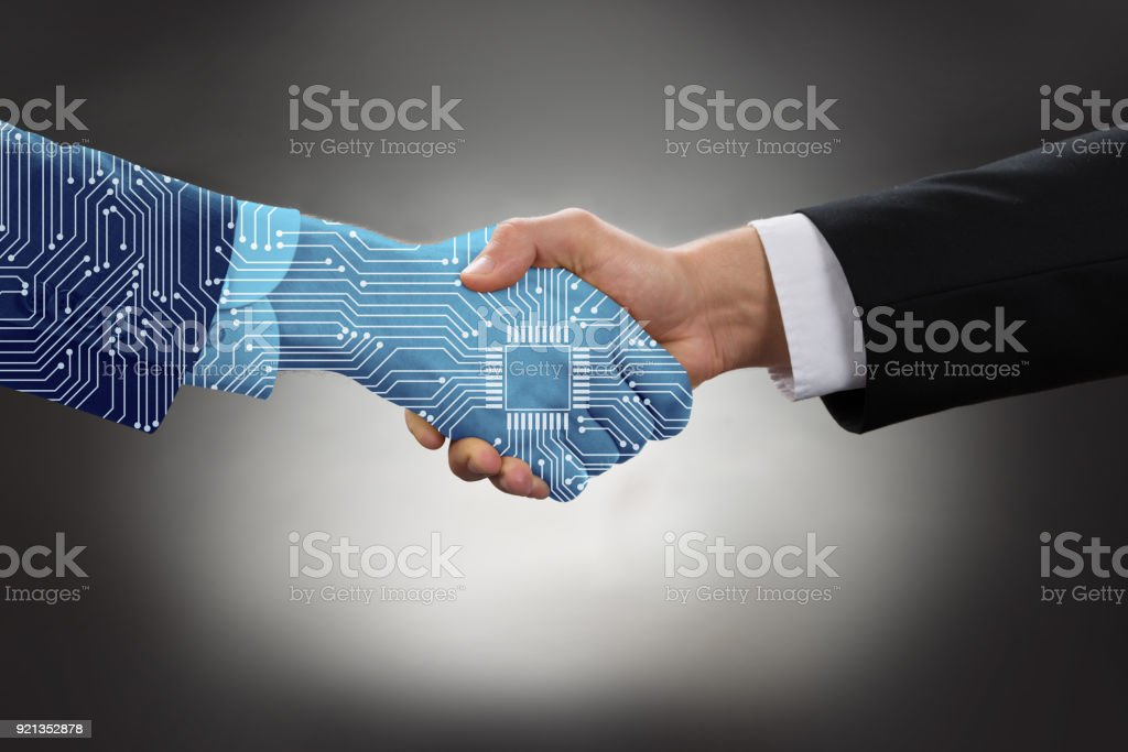 Businessman Shaking Hands In Front Of Mallet stock photo