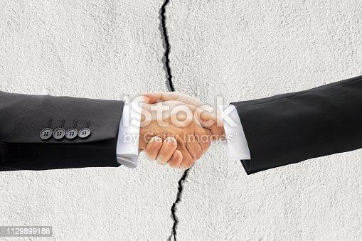 istock Businessman Shaking Hands 1129899186