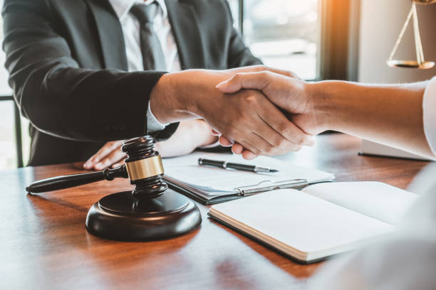 7,252 Lawyer Handshake Stock Photos, Pictures & Royalty-Free Images - iStock
