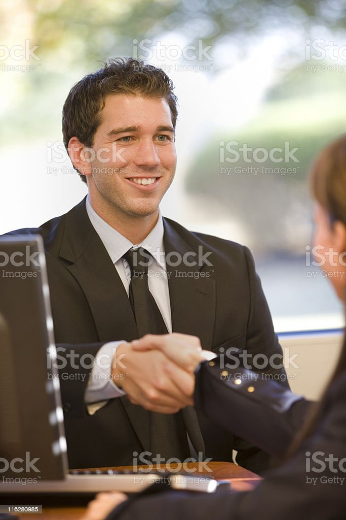 Businessman Shaking Hands with A Woman royalty-free stock photo