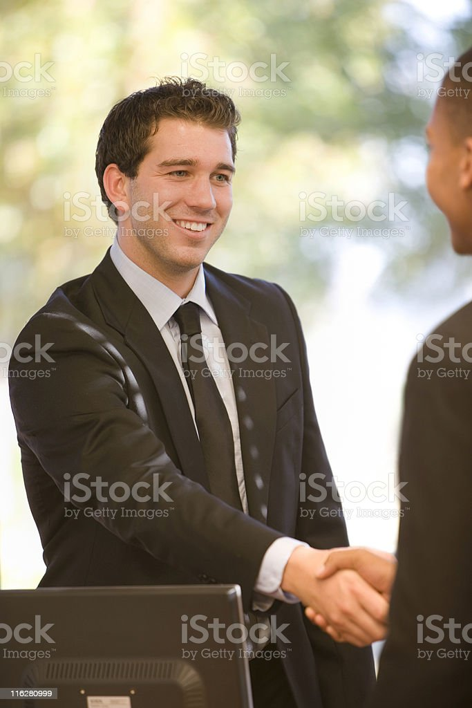 Businessman Shaking Hands With Another Man royalty-free stock photo