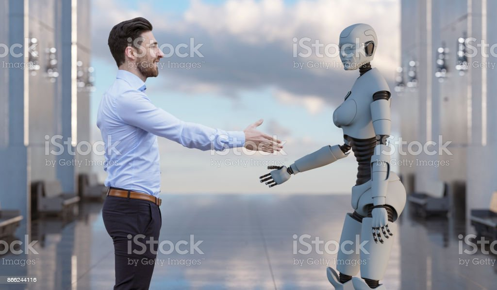 Businessman shaking hands with futuristic cyborg stock photo
