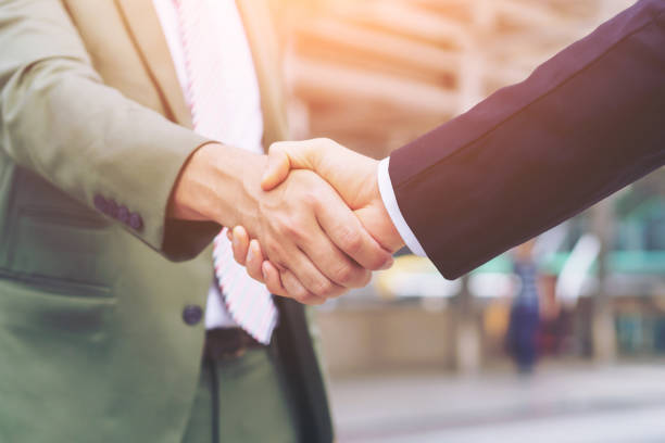 Businessman shaking hands with partner. Concept of deal successful and negotiation agreement. stock photo