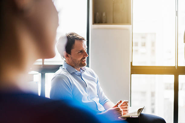 businessman sharing ideas in meeting room - selective focus stock pictures, royalty-free photos & images