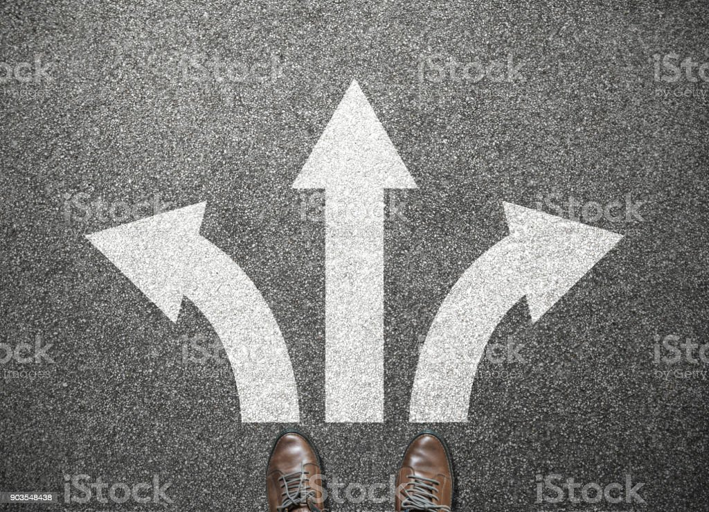 businessman shoes stand at junction, choose way to success stock photo