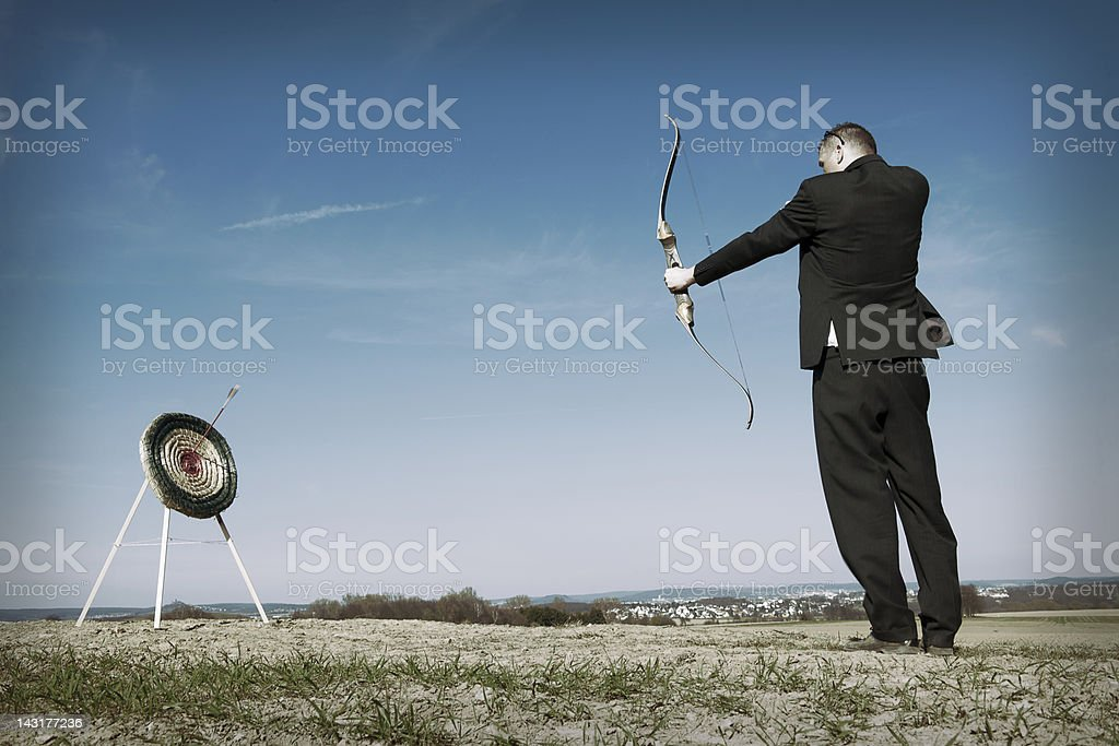 Businessman shooting on target stock photo