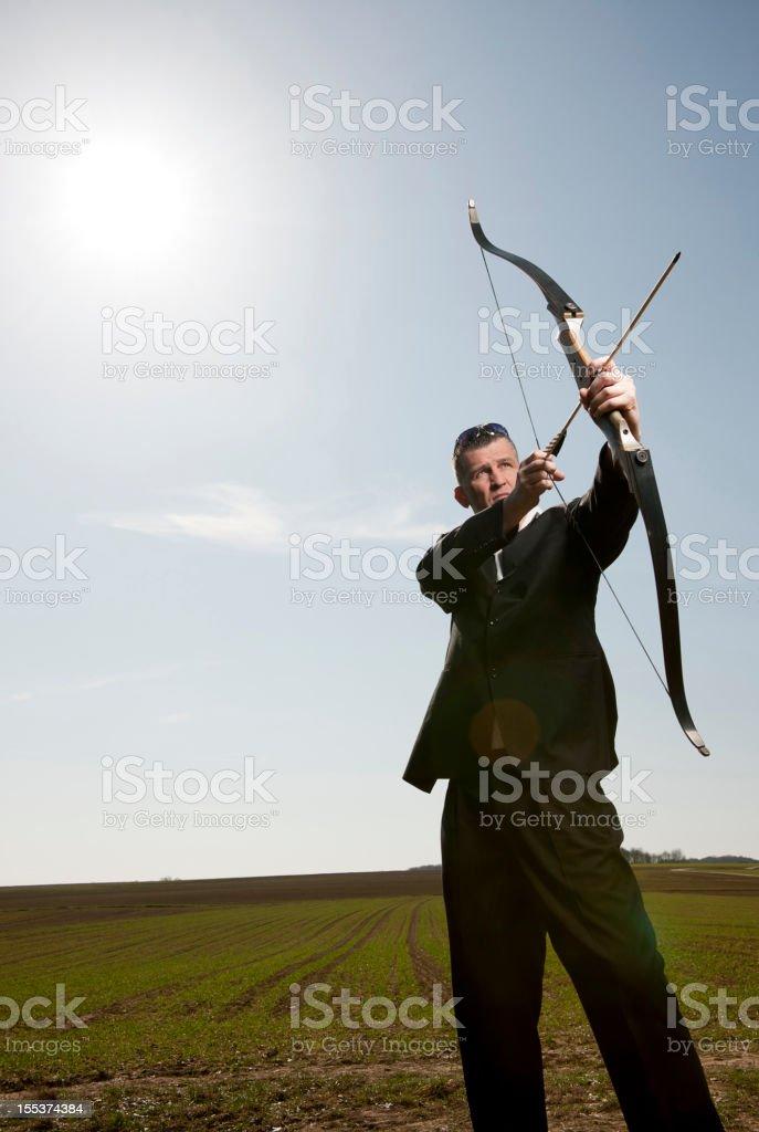 Businessman shooting on target royalty-free stock photo
