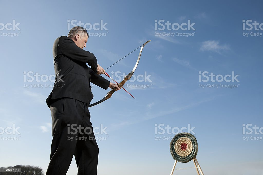 Businessman shooting on target stock photo