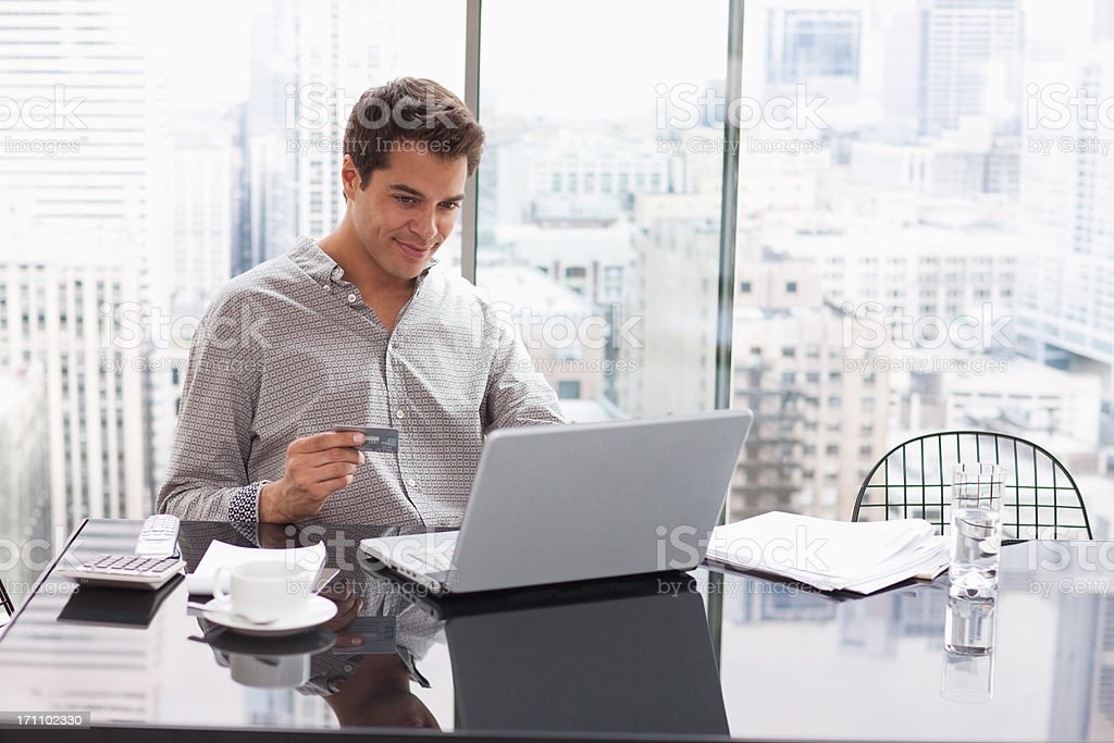 Businessman shopping online with credit card stock photo