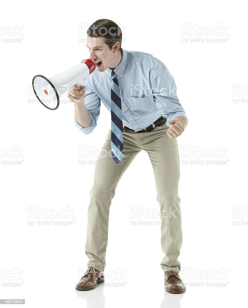 Businessman shouting into a megaphone royalty-free stock photo