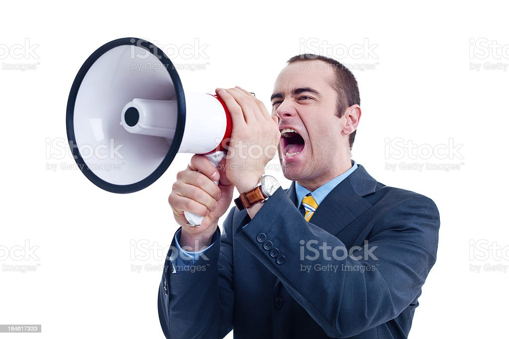 Businessman shouting into megaphone royalty-free stock photo