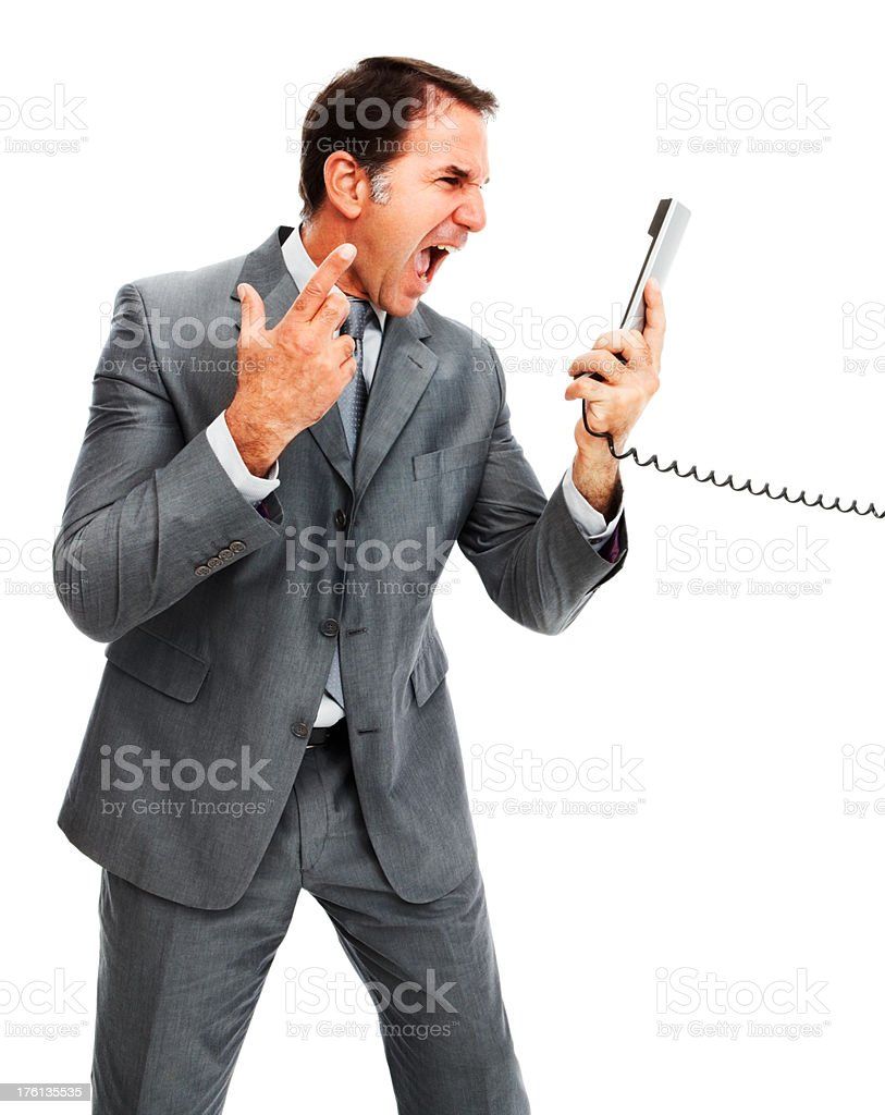 Businessman shouting over the phone against white backgrounf royalty-free stock photo