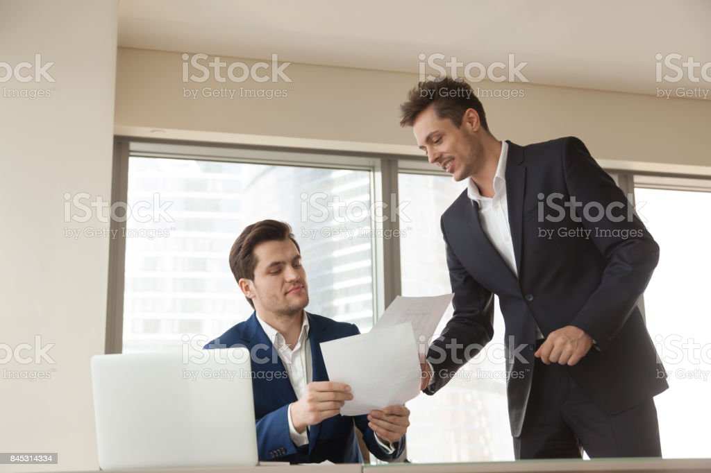 Businessman shoving project documents to investor stock photo