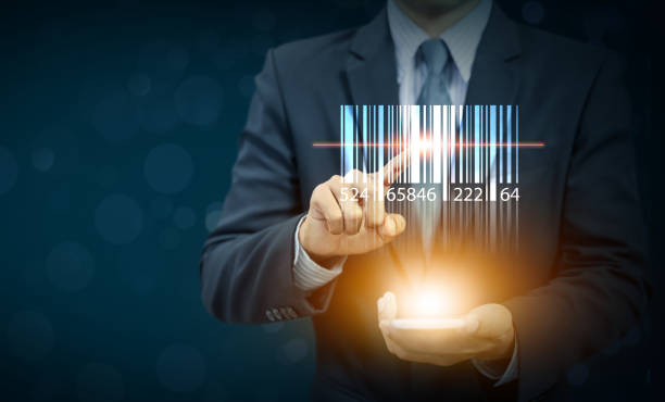 Businessman show barcode with glow light on hand, warehouse and logistics stock photo