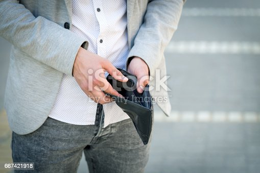 istock businessman show his empty wallet 667421918