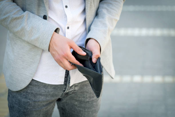 businessman show his empty wallet stock photo
