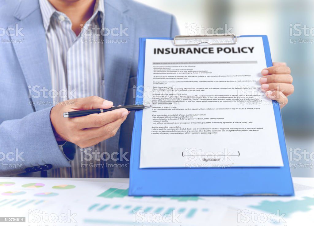 businessman show insurance policy with business graph diagram, insurance concept stock photo