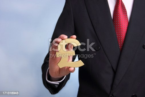 Businessman showing  a British Pound symbolSome other related images: