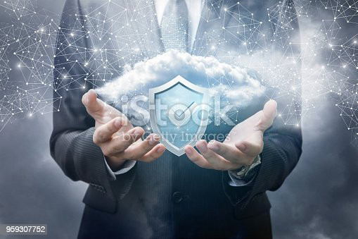 1156072209istockphoto Businessman showing a data cloud with effective protection . 959307752