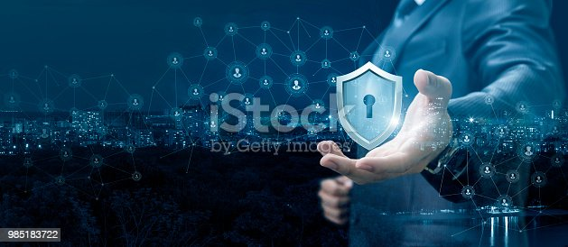 istock Businessman showing a shield of protection network. 985183722