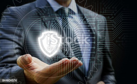 istock Businessman showing a shield protection . 844604574