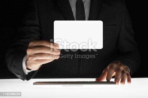 844190384 istock photo Businessman showing blank card 1132096250