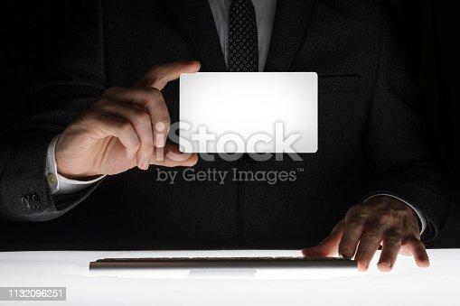 844190384 istock photo Businessman showing blank card 1132096251