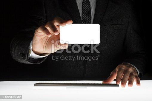 844190384 istock photo Businessman showing blank card 1132096252