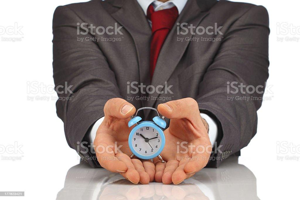 Businessman showing blue alarm clock royalty-free stock photo