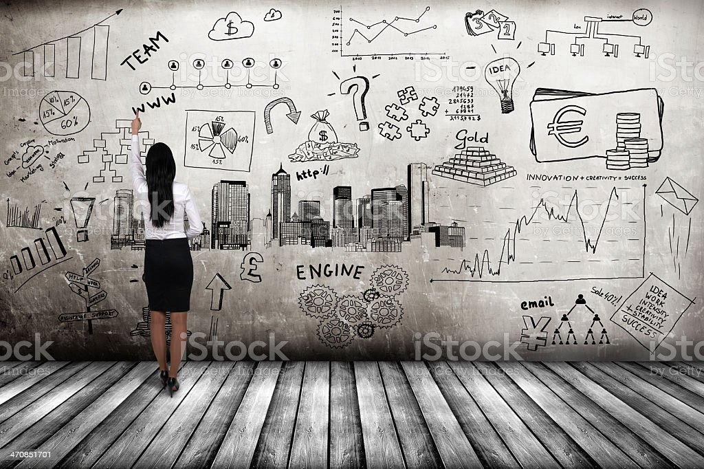 businessman showing business concept on wall stock photo