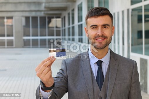 844190384 istock photo Businessman showing card in office space 1004212550