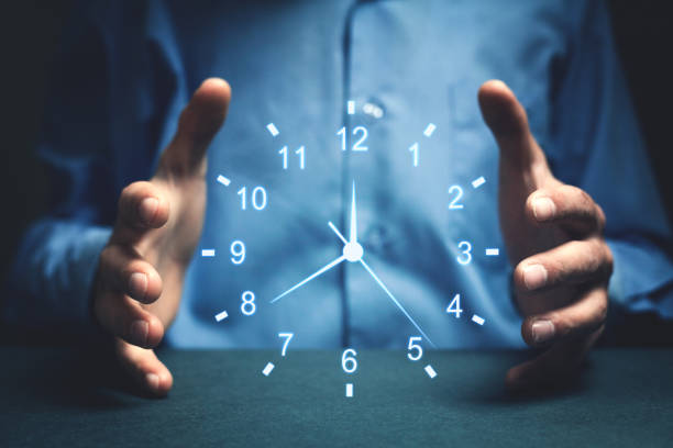 Businessman showing clock. Concept of saving time. stock photo