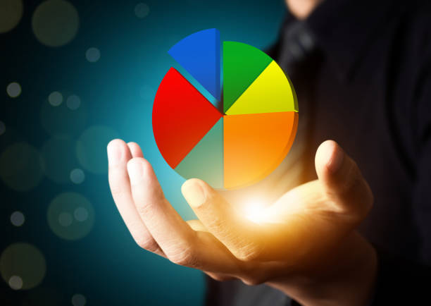 Businessman showing colorful pie graph stock photo