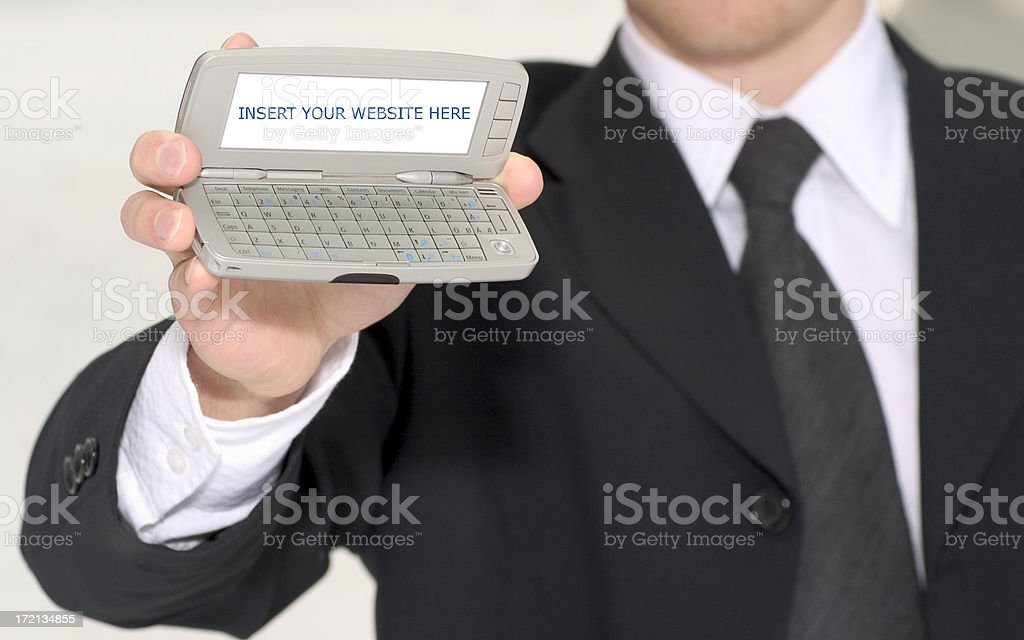 businessman showing communicator royalty-free stock photo