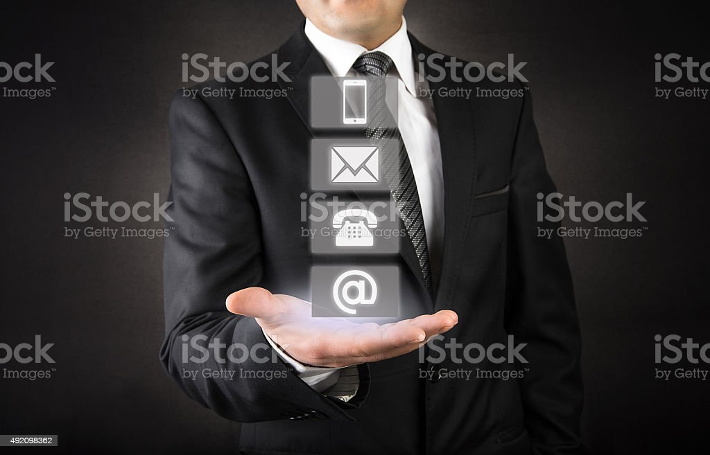 Businessman showing contact and support icons stock photo