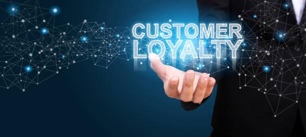 businessman showing customer loyalty. customer loyalty concept. - fedeltà foto e immagini stock