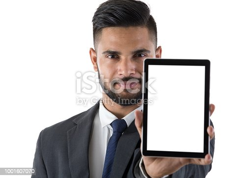 682621548istockphoto Businessman showing digital tablet 1001607070