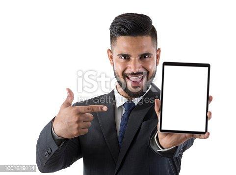682621548istockphoto Businessman showing digital tablet 1001619114
