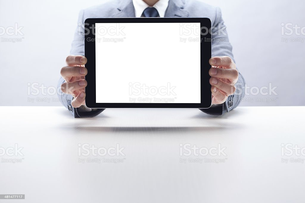 Businessman Showing Digital Tablet stock photo
