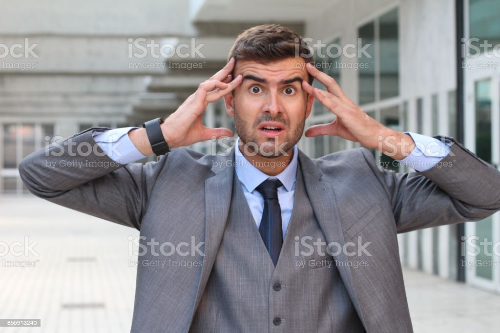 Businessman showing fear and stress close up.