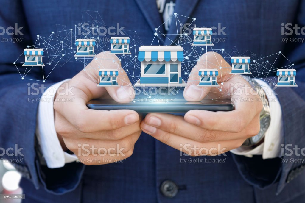 Businessman showing Franchise system on a mobile . Businessman showing Franchise system on a mobile device. Adult Stock Photo