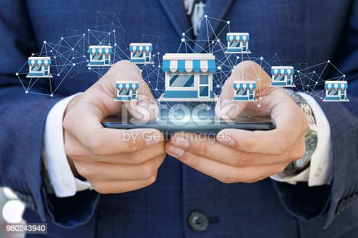 Businessman showing Franchise system on a mobile device.