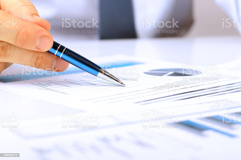 Businessman showing graphs by pen stock photo