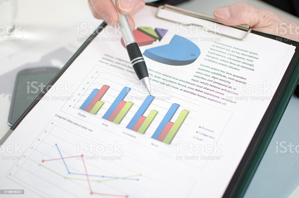 Businessman showing graphs stock photo