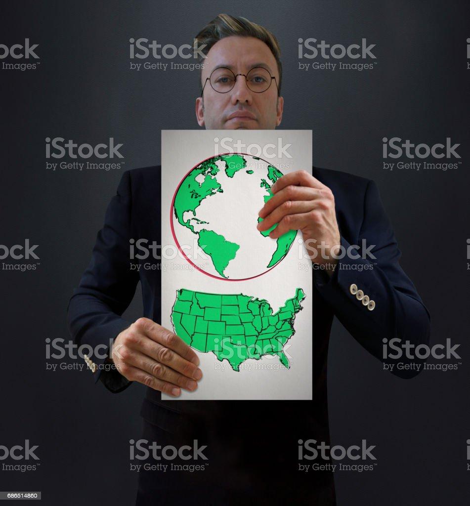 Businessman Showing Green USA and World zbiór zdjęć royalty-free