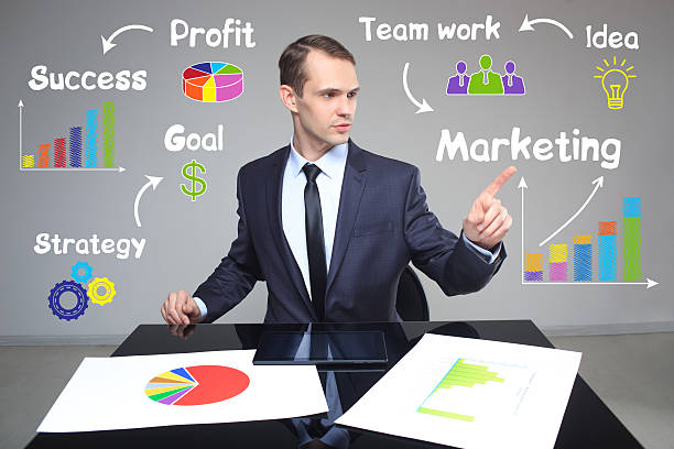 businessman showing growth rates in the chart. business concept - rates stock photos and pictures